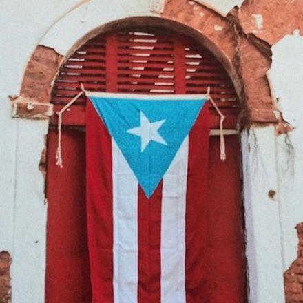 Puerto Rican Flag in doorway.